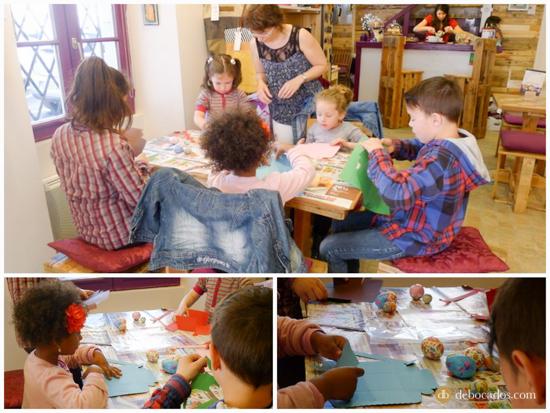 El grupo de niños muy concentrado decorando sus huevos de pascua y haciendo las cestas de cartón.